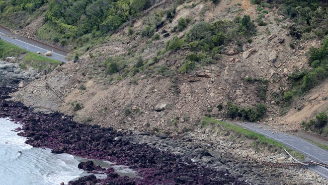 FILE - In this Monday, Nov. 14, 2016 file photo, landslide damage on State Highway One and the main trunk railway line are seen following an earthquake, north of Kaikoura, New Zealand. In terms of human life, the magnitude 7.8 earthquake that hit New Zealand this month was relatively merciful: just two fatalities. But geologically, it moved roads and mountains and even displaced the sea, leaving a formidable mark from which tourism, farming and life in general may need years to recover.