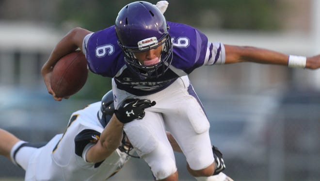 Cypress Lake's Keyon Brawner is tackled by Bishop Verot's Trey Oakley during a spring football game at Cypress Lake High School on Wednesday.