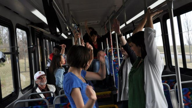 Members of Pones Inc. dance on public transit. The group will perform again on a bus Tuesday in Covington.