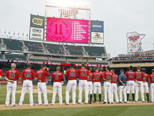 Minnesota Twins players line up on the first base line