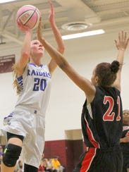 Marlea Nolan of Horseheads drives to the basket as