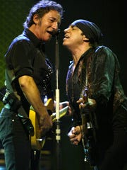 """Bruce Springsteen (left) is joined on his microphone by E Street Band member """"Little"""" Steven Van Zandt during """"The Rising"""" as Bruce  the band close out a 10 night stand at Giants Stadium in 2002."""