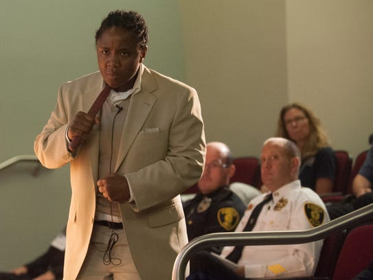 Camden County Police Detective Cabria Davis re-enacts
