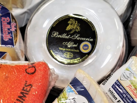 Brillat Savarin is a fairly recent cheese invention in France. It is a decadent cheese, with 75% butterfat in dry matter. Try it with a bubbly white wine and sweet-tart berries.