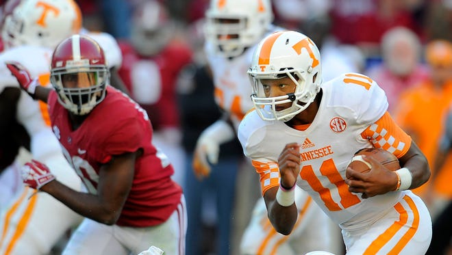 Tennessee quarterback Joshua Dobbs (11) runs with the ball during his first game with the Vols on Oct. 26, 2013 at Alabama.