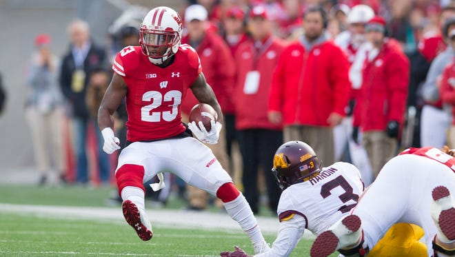 Wisconsin Badgers running back Dare Ogunbowale (23) rushes with the football during the first quarter against the Minnesota Golden Gophers at Camp Randall Stadium.
