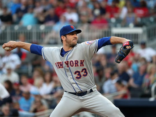 Mets starting pitcher Matt Harvey (33) delivers a pitch to an Atlanta Braves batter in the first inning at SunTrust Park on Friday, June 9, 2017 in Atlanta.
