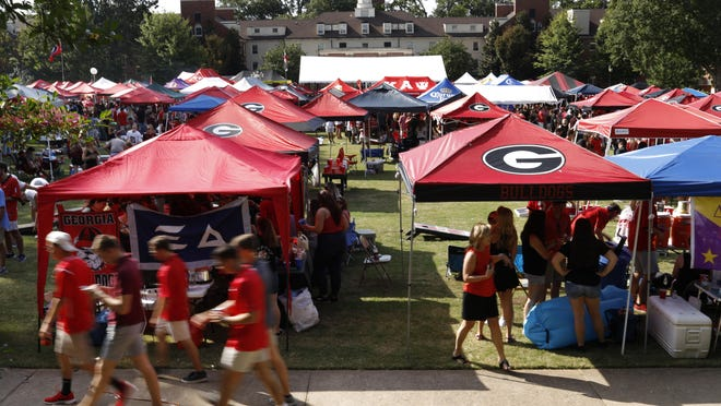 Fans tailgate at the Mary's Quad before the start of an NCAA college football game between Georgia and Vanderbilt at Sanford Stadium in Athens, GA., Saturday, Oct. 6, 2018.