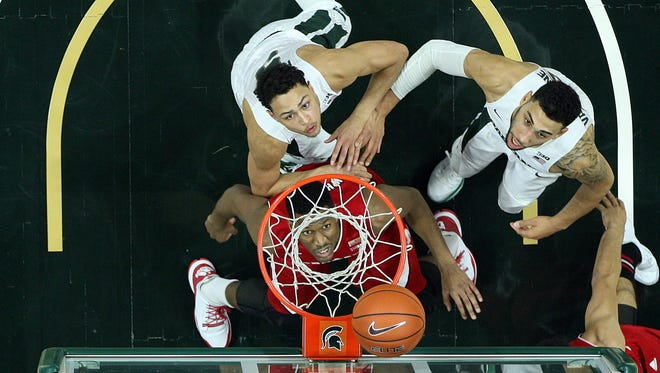 MSU's Denzel Valentine, right, and Bryn Forbes, left, anticipate a rebound against Nebraska on Wednesday night. The Spartans lost 72-71 for their third straight defeat.