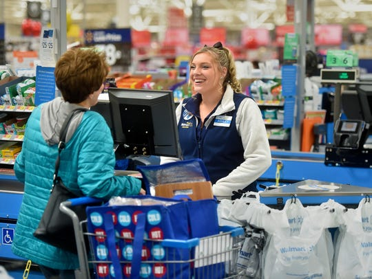 Walmart says it is raising the hourly wage for employees and offering bonuses of up to $1,000 for associates.
