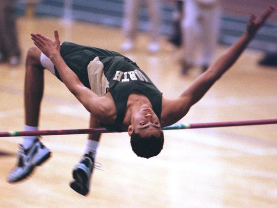 Darrin Charles clears the bar during the high jump