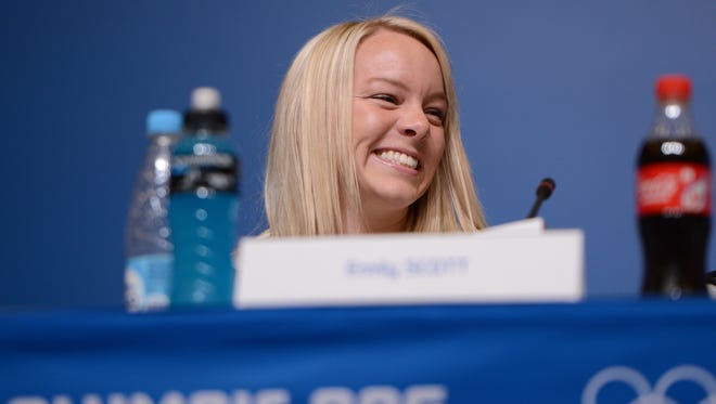 Emily Scott addresses the media in a press conference prior to the Sochi Winter Games at the Main Press Center-Dostoyevsky Hall on Tuesday.