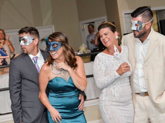 "Phil and Kaitlin Goedeke, left, and Lindsey and Adam Modert compete for best costume at The Royal Palms annual fundraiser, ""A Masquerade Gala."""