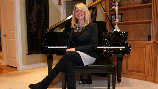 Vicki Rogers poses for Style Maker photos at her home in Louisville, Kentucky.       December 29, 2015