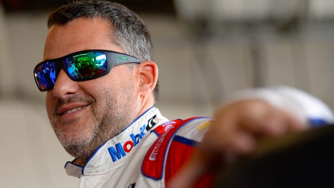 Tony Stewart, driver of the #14 Haas Automation Chevrolet, stands in the garage during practice for the NASCAR Sprint Cup Series Cheez-It 355 at Watkins Glen.