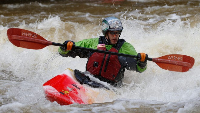 17 whitewater kayakers and playboaters compete in playboating at the Lower Cato Falls County Park on Saturday, March 19 in Reedsville. Jeremiah Kramasz, of Sheboygan Falls, took the first place as he completed higher-scoring tricks such as a blunt and a loop.