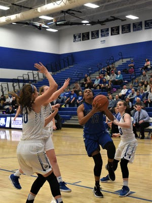 Zanesville's Tasia Staunton goes up for a shot against three Cambridge defenders in Saturday's 56-43 loss in the Division II sectional final.
