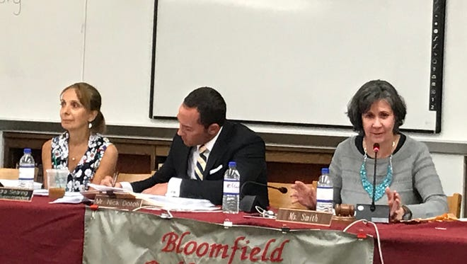 Assistant Superintendent Sandra Searing, Director of Administration Nicholas Dotoli and Board President Emily Smith prepare for the Bloomfield Board of Education meeting on June 27, 2017.