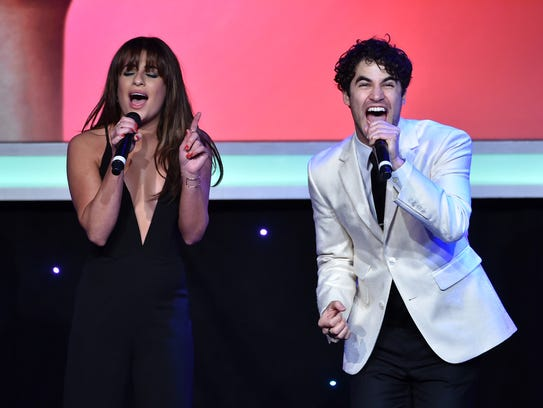 Honorees Lea Michele (L) and Darren Criss perform onstage