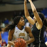 University of Great Falls star Nneka Nnadi, left, looks to score.
