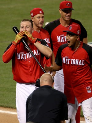 The Reds' Todd Frazier blows a kiss toward the crowd after winning the Home Run Derby.