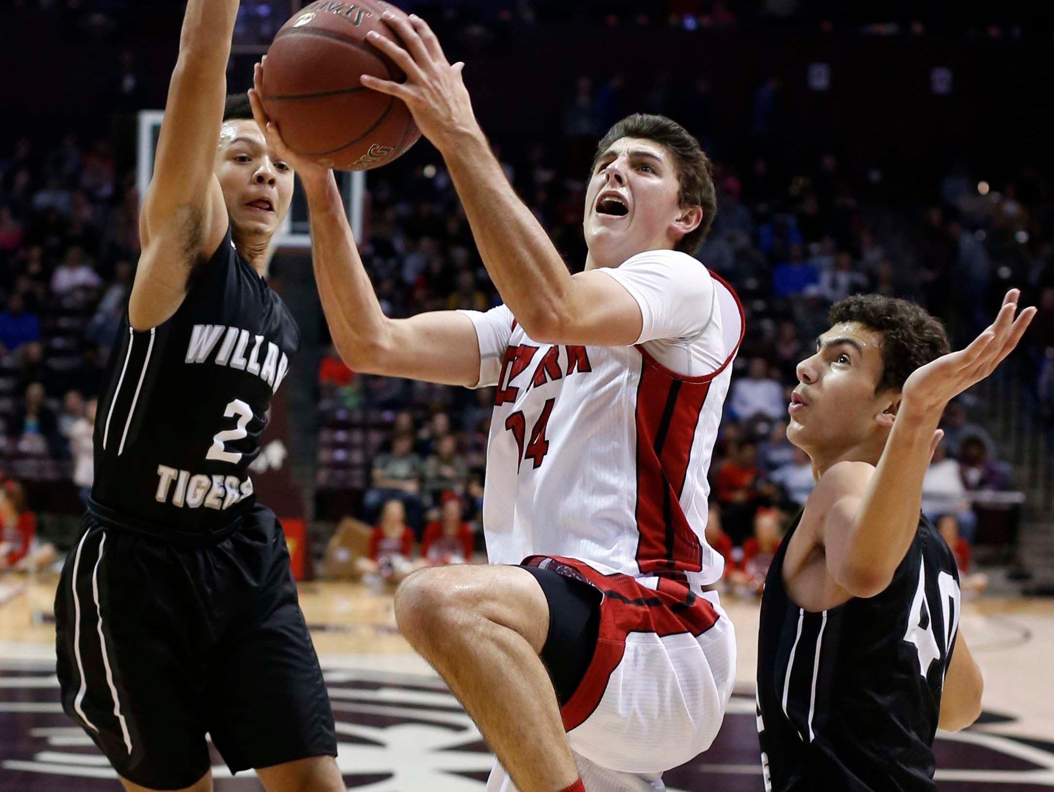 Ozark's Parker Hanks looks to score against Willard in the Gold division final at JQH Arena on December 29, 2016.