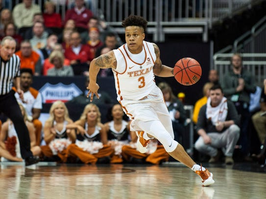 Texas Longhorns guard Jacob Young (3) dribbles the