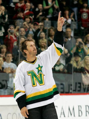 Dallas Stars center Mike Modano acknowledges the crowd after skating on to the ice in his Minnesota North Stars jersey after the Dallas Stars defeated the Minnesota Wild 4-3 in a shootout in their NHL hockey game in St. Paul, Minn. Saturday, April 10, 2010.(AP Photo/Andy King)