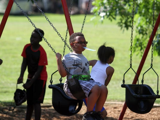636639900248373672-Darrion-Graham-takes-a-swing-at-Thursday-s-Bel-Aire-Park-Opening-36-.JPG