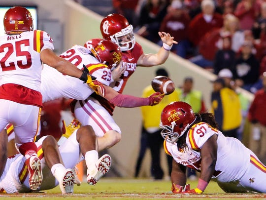Oklahoma quarterback Baker Mayfield (6) fumbles the ball as Iowa State linebacker Kane Seeley (29) reaches for the recovery during the first quarter of an NCAA college football game in Norman, Okla., on Saturday, Nov. 7, 2015.