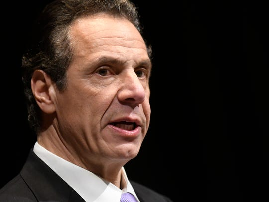 New York Gov. Andrew Cuomo delivers his 2018 executive state budget proposal during a news conference at the Clark Auditorium in Albany, on Tuesday.