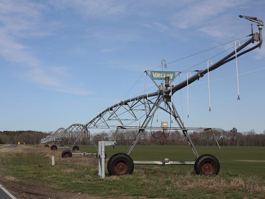 A field irrigator awaits planting season in Dorchester