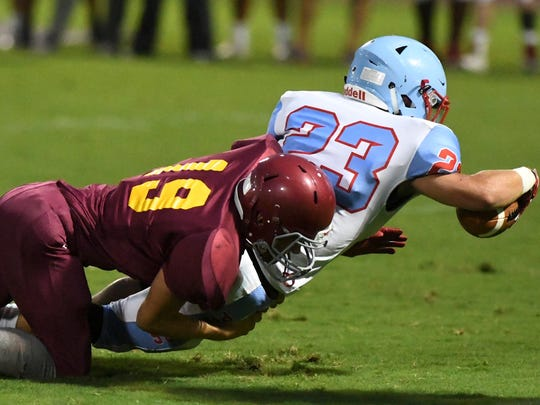 Humboldt's Adam Hartig tackles Gibson County's Ozzy Rico during their game at the Sports Plus High School Football Jamboree, Friday, August 11, 2017.