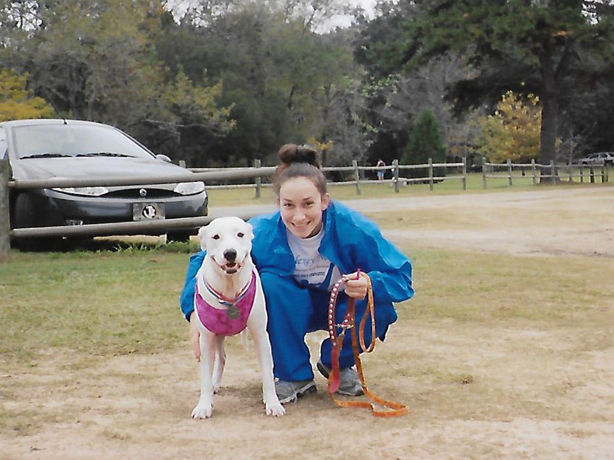 "Jennifer ""Casey"" Norred with her American bulldog, Sam."