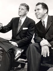 EVANGELIST BILLY GRAHAM, LEFT, AND VICE PRESIDENT RICHARD NIXON RELAX DURING A BREAK AT A CONFERENCE OF THE PRESBYTERIAN MEN'S COUNCIL OF APPALACHIA IN 1956 AT MONTREAT, WHERE NIXON WAS THE FEATURED SPEAKER.