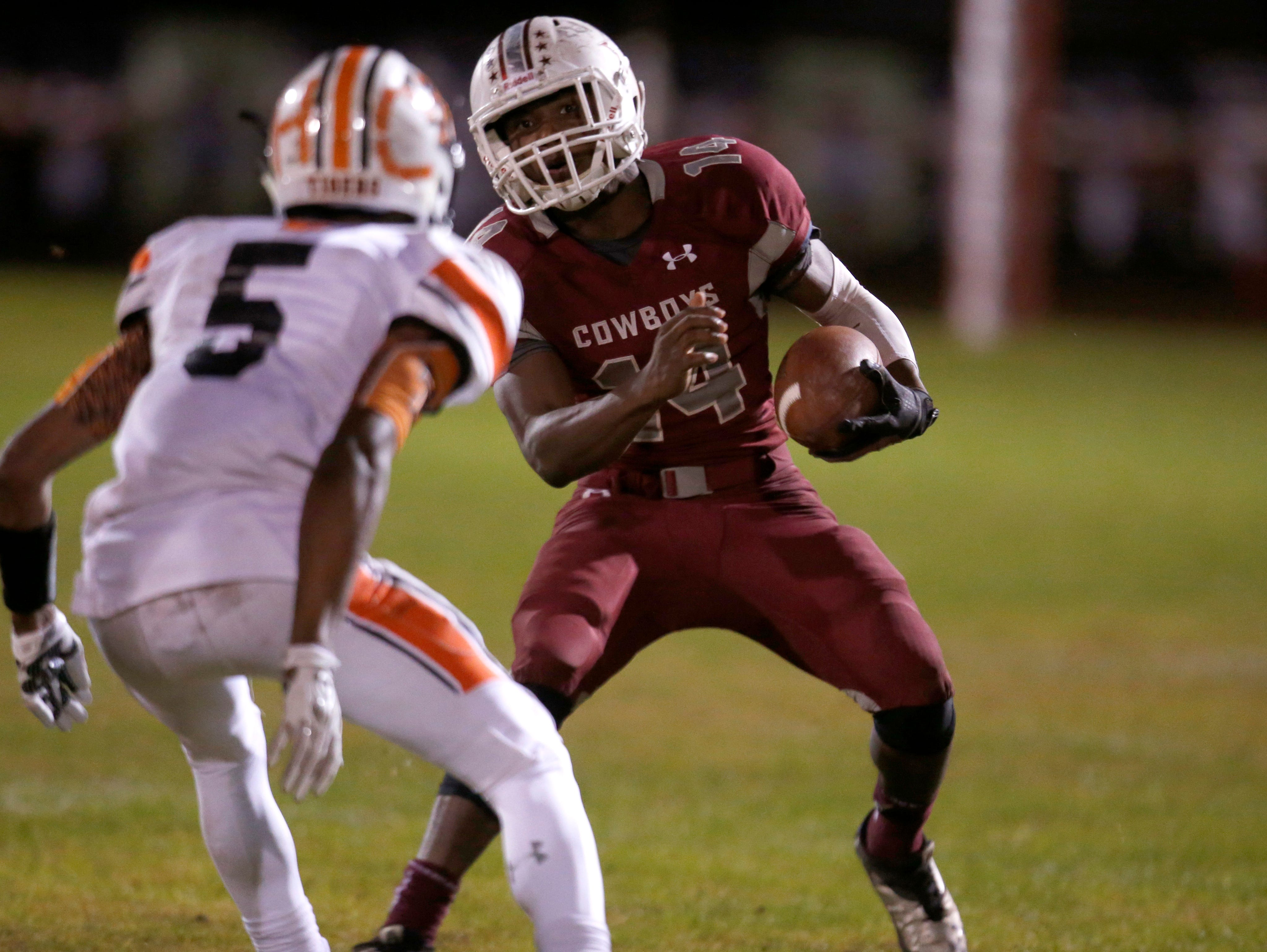 Madison County's Kentwan Daniels tries to get past Trenton defender Hamp Cheevers during their playoff game on Friday.