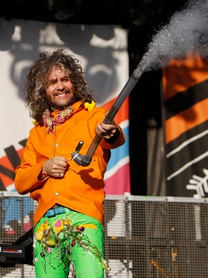 Wayne Coyne of The Flaming Lips pumps up the crowd before the concert at the Gentlemen Of The Road Stopover Saturday, June 20, 2015, in Waverly, Iowa.