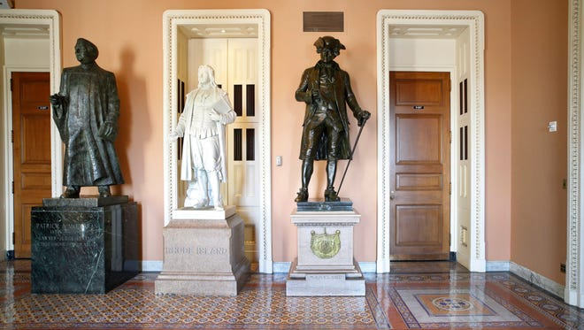 A larger-than-life bronze statue of Patrick A. McCarran of Nevada, left, stands near the entrance to the Senate floor on Capitol Hill in Washington. Beside McCarran are statues of Roger Williams of Rhode Island, middle, and John Hanson, president of the Continental Congress from Maryland during the era of the American Revolution.