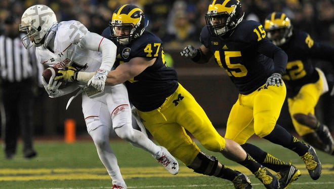 Michigan Wolverines linebacker Jake Ryan (47) takes down Maryland Terrapins wide receiver Jacquille Veii (34) in the first quarter.