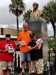"""Lee natives Jeff Hornsby (right), Larry Tiner ((left) and Steve Herzog show their support to """"Keep Lee in Lee"""" alongside a bust of Civil War Gen. Robert E. Lee on Monroe Street in Fort Myers, FL."""