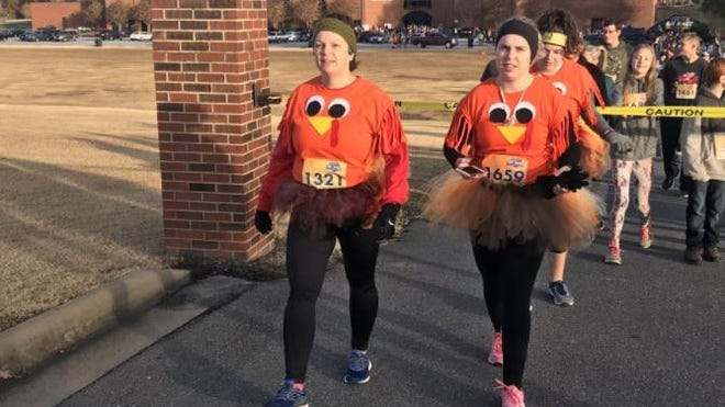 Runners decked out in turkey gear head to the starting line during the 2019 Ruby C. Hunt YMCA Turkey Trot. For the runs 23rd year it is going virtual.