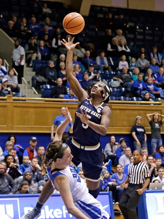Notre Dame's Jackie Young (5) drives to the basket while Duke's Rebecca Greenwell defends during the first half of an NCAA college basketball game in Durham, N.C., Sunday, Feb. 4, 2018. (AP Photo/Gerry Broome)