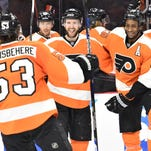Flyers celebrate a 2-1 victory over Washington Wednesday night in Philadelphia.