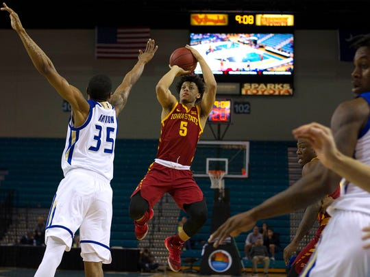 Iowa State Cyclones guard Lindell Wigginton (5) shoots the ball against Tulsa Golden Hurricane forward Geno Artison (35) during the first half at The HTC Center.
