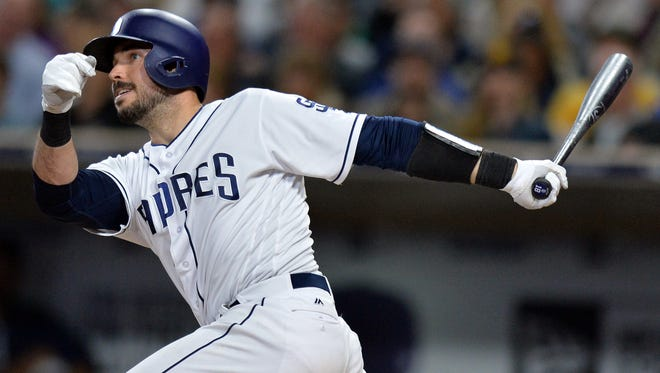 San Diego Padres catcher Austin Hedges hits a two-run RBI double against the Chicago Cubs at Petco Park.