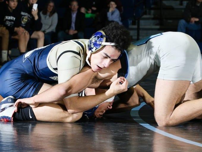 Roxbury battles West Morris in the wrestling North