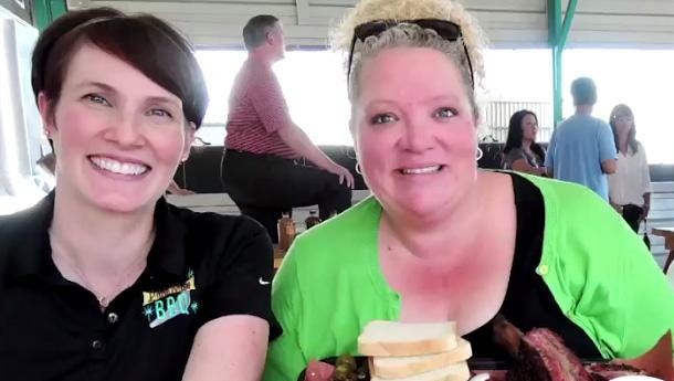 """Bekke Holmes (left)  of Little Miss BBQ feasts with Danielle Dimovski of Travel Channel's """"BBQ Crawl."""""""