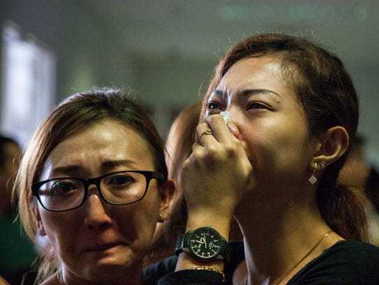 Weeping relatives await news of the Air Asia missing