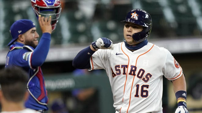Houston Astros' Aledmys Diaz celebrates after hitting a three-run home run during the team's 8-4 win over the Texas Rangers on Thursday.
