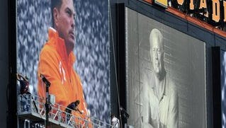 Workers securing a photo of Tennessee coach Butch Jones along side Gen. Neyland on the jumbotron at Neyland Stadium Thursday.